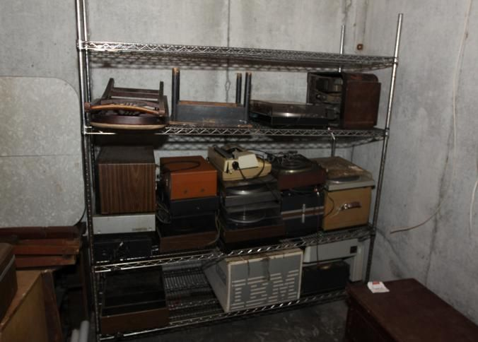 Assorted record players and vintage radios, electric typewriter, Panasonic VHS player JVC VHS player, GoldStar microwave, etc. Buyer must take all. Excluding the shelf.