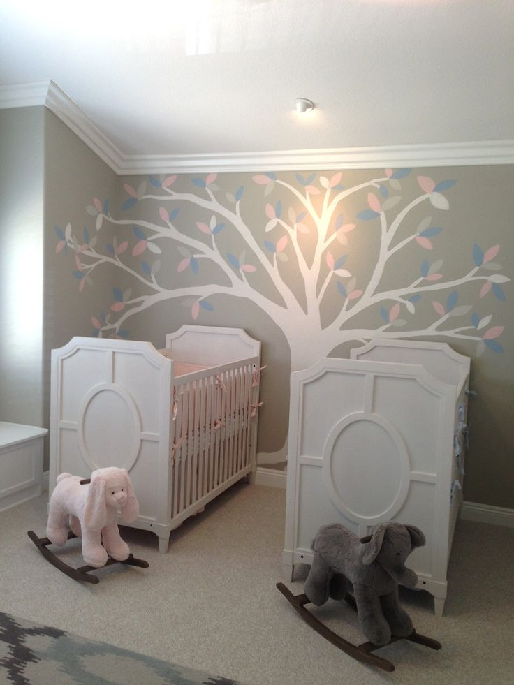 Nursery for twins. Grey with hand painted tree and leaves. Lucky baby boy and girl twins
