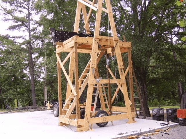 Portable Scaffolding by NASMAN -- Homemade portable scaffolding constructed from lumber, wheels, pipe, and an electric winch. http://www.homemadetools.net/homemade-portable-scaffolding