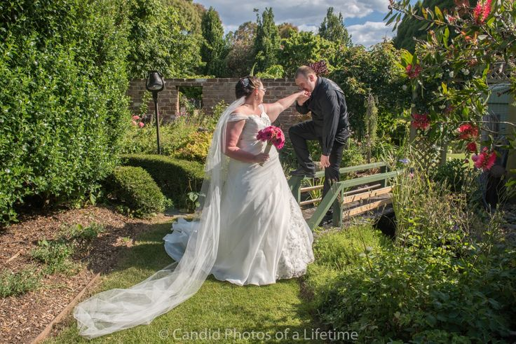 Candid Photos of a Lifetime - A tender kiss on the hand from the groom - Gairloch Garden, Oberon  Gairloch Garden Oberon is the perfect location for wedding formals. www.candidphotosofalifetime.com.au