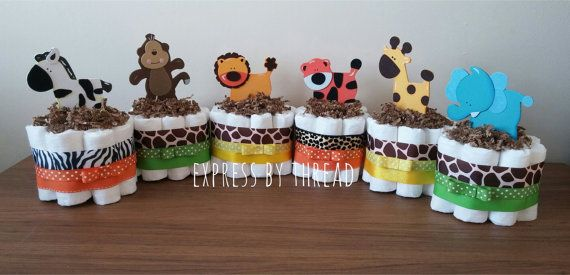 These safari mini diaper cakes are perfect for any baby shower! They work well for a boy or girl! Colors of ribbon can be changed as well as, paper shred, and wooden animal toppers. If you would like other ribbon colors other than the orange and green used in the first picture, please