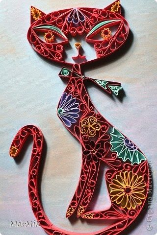 Quilled cat. I'm certain someone put time & effort into this,  but wouldn't it be the birthday gift you packed away in the attic?
