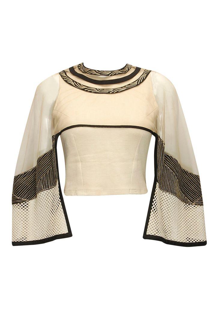 Off-white and black zari cape top by Ridhima Bhasin. Shop now: http://www.perniaspopupshop.com/designers/ridhima-bhasin #cape #shopnow #ridhimabhasin #perniaspopupshop