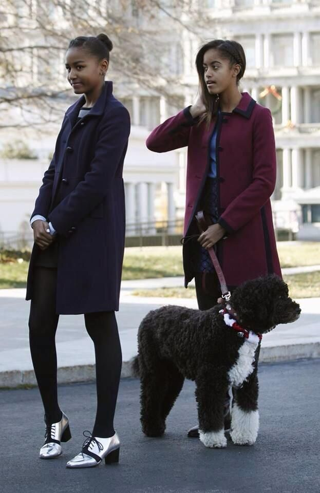 Sasha and Malia Obama wearing gorgeous coats and Sasha wearing striking shoes....