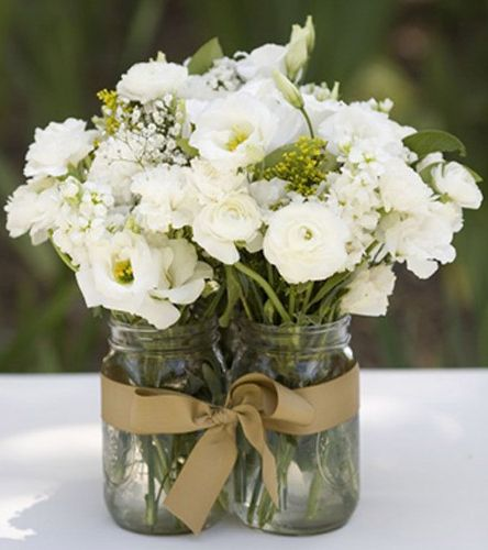 Mason Jar Centerpieces Tied Together; gold and teal ribbon with white flowers