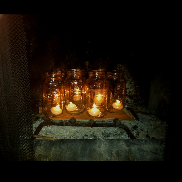 Old Jars And Tea Light Candles In A Fireplace Great