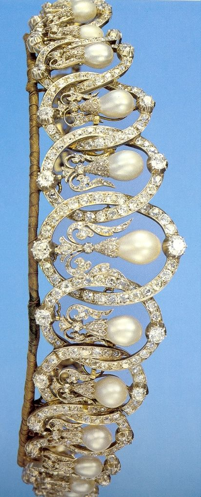 A diamond and natural pearl belle epoque tiara, circa 1905. Featuring thirteen interlocking diamond ovals, with larger, circular diamonds at the top and bottom of each oval; with pear-shaped upright natural pearls within each oval, supported by diamond foliates