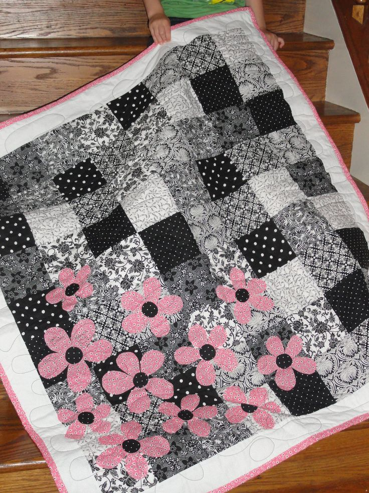 Black and white quilt with pink flowers!  Really need to do this. (Back and white family photos  on fabric ???)cooool