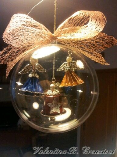 Nespresso Angels and bell in a Christmas decoration