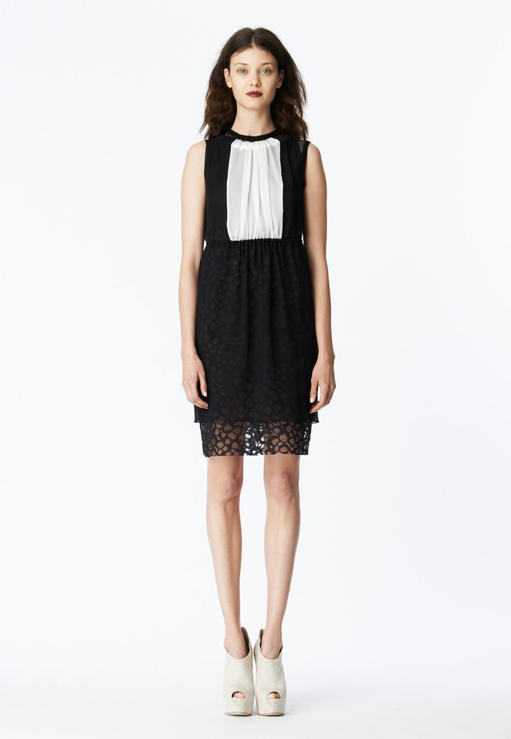 Vera Wang - LOOK 15 Black and white silk chiffon bi-color gathered neck shift dress layered over black stretch net t-shirt dress with black honeycomb lace skirt.