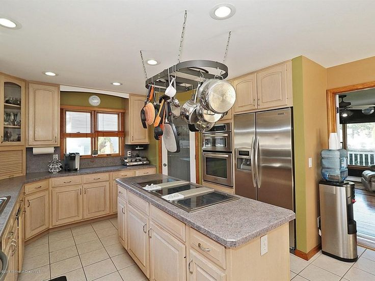 Craftsman Kitchen with Formica Laminate - Fog Dust, Simple Granite, Old Dutch Oval Hanging Pot Rack, Glass panel, Stone Tile