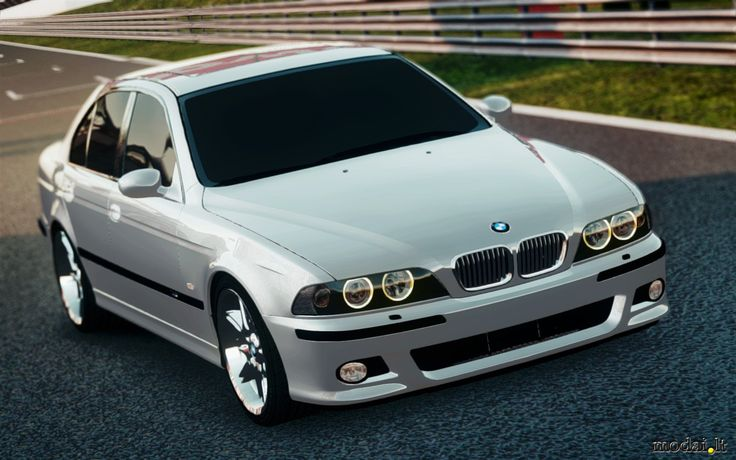 BMW E39 Silver with dark window tinting, polished rims