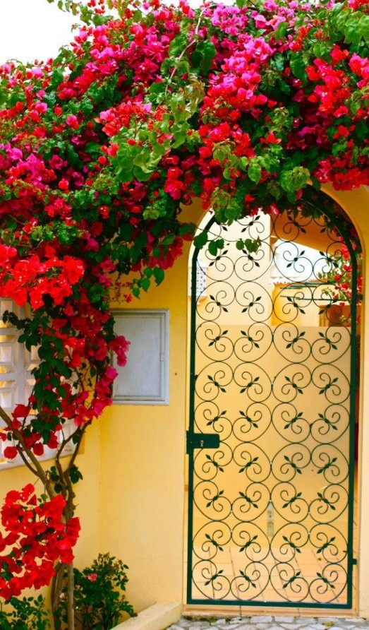 Colorful courtyard gate entry in the Faro District of Olhos de Água, Algarve, Portugal