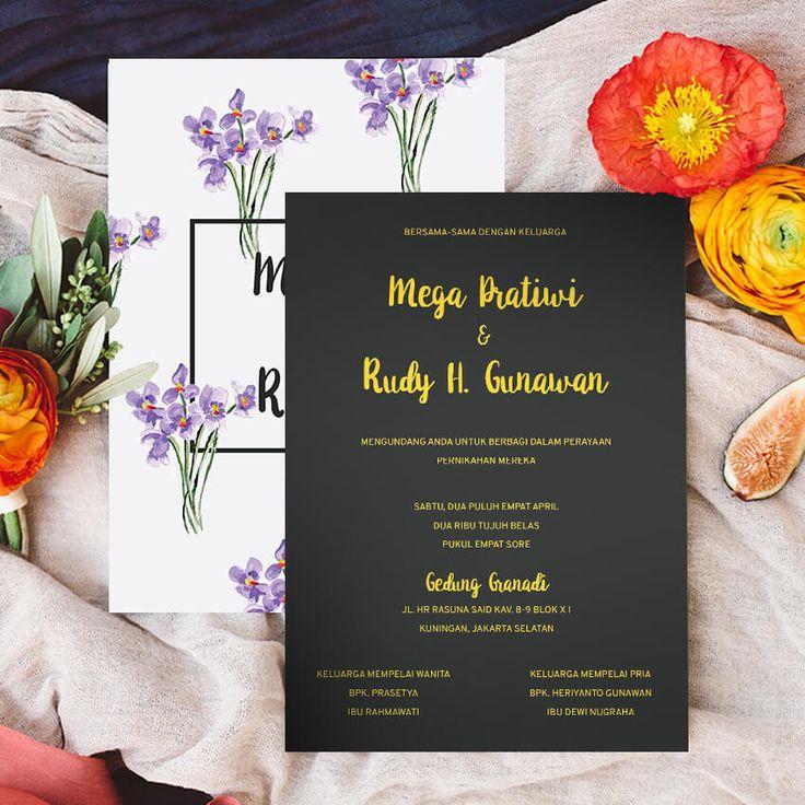 Elegant Botanical Wedding Invitation. Undangan pernikahan yang elegan dan cantik ini menampilkan tumbuhan yang indah. Kaligrafi emas disematkan pada nama-nama pengantin dengan tema yang klasik. Amplop berwarna ungu menambah kesan mewah untuk undangan ini.