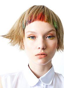 Peekaboo micro bang colors with a wispy blonde pixie.