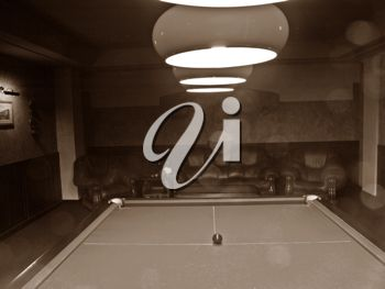 Royalty Free Photo of a Billiard Room With a Pool Table Under Lights