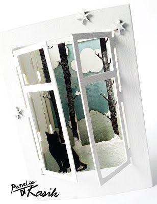 Zimowe okno z czarnym kocurem :)