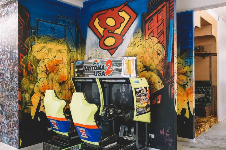 Work hard, play hard. A prominent feature of the Gaze Head Office, and well loved by its employees, our Daytona racing game never fails to catch the attention of our visitors who naturally want to race straightaway. Gaze Auckland Office, by Gaze.  #office #design #games #interiordesign #commercialinterior