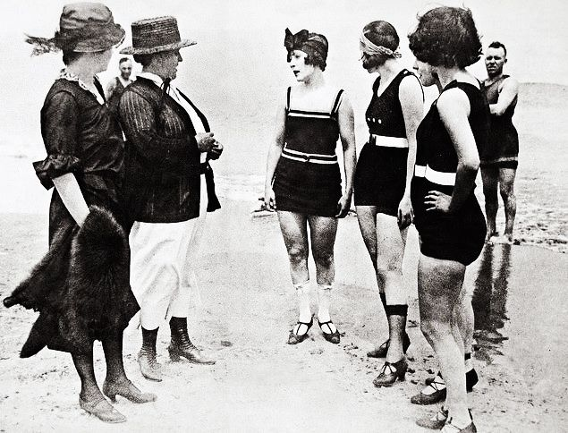 "Young women arrested on a Chicago bathing beach for wearing ""lewd"" bathing suits, 1922"