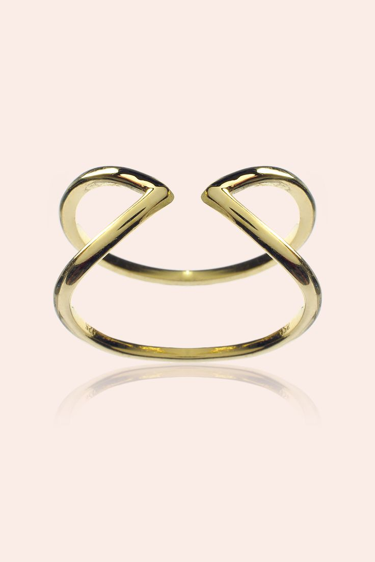 Criss cross inspired design. This minimal designed hollow band ring is a perfect accompaniment to any fine stacking rings to create a lasting impact.   Thickness of band: 1.5mm Size: (Adjustable) Material: 9CT Gold Vermeil on 925 Sterling silver. This piece of jewellery is hand forged in New Zealand. We offer free shipping and 20 day returns policy. Price shown is in New Zealand dollars.