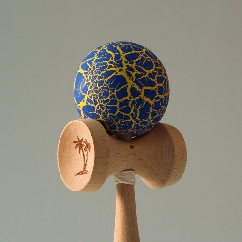 """Bahama Kendama Crackle - Blue over Gold by Bahama Kendama. $21.99. Bahama Kendama Standard Sized Kendama with a Crackle """"Sunburn"""" Finish on the Ball. The colors are spectacular on these crackle painted kendamas! Feel the Burn!Specs:Weight: 5.0 ounces (145 g);Length from handle to tip: 6.375 inches."""