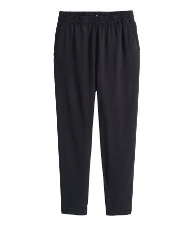 Pants in textured woven fabric. Elasticized waistband, gently tapered legs, side pockets, and one back pocket.