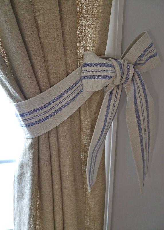 gorgeous burlap drapes + blue striped ribbon.