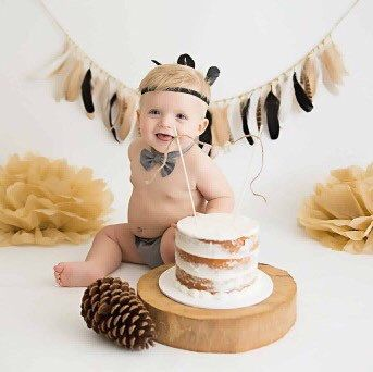 This gorgeous boy loved his cake smash. Featuring our Wild One Feather Garland and our Feather Crown