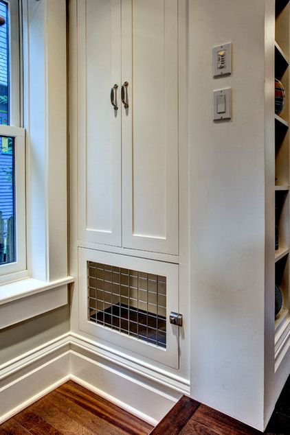 A dog crate was built into a storage unit dividing the kitchen and entry hall. Grilles on both sides provide cross ventilation, as well as v...