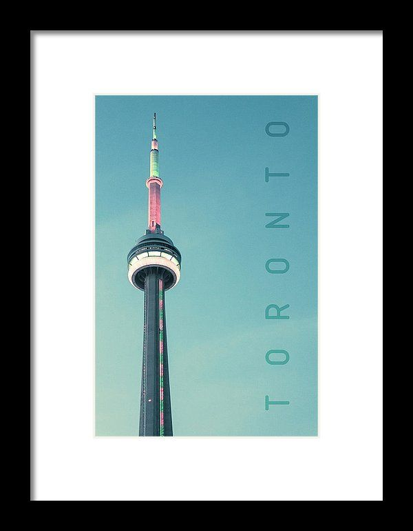 Cn Tower Framed Print by Mc. All framed prints are professionally printed, framed, assembled, and shipped within 3 - 4 business days and delivered ready-to-hang on your wall. Choose from multiple print sizes and hundreds of frame and mat options.
