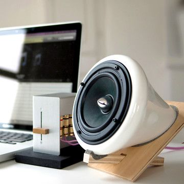 Joey Roth Design - Ceramic computer speakers. $495.  Gorgeous, and so clever in the cantilever stands!