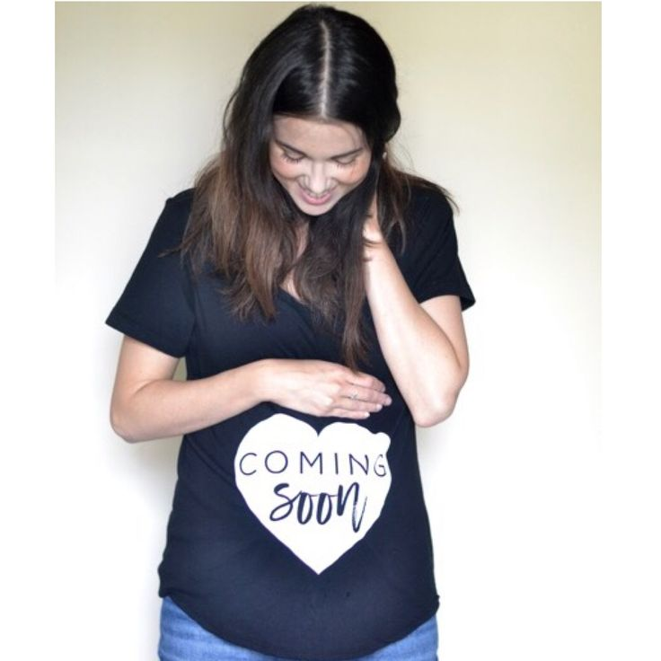 "Looking for the perfect maternity shirt? You will love this cute mom-to-be black cap sleeve t-shirt with the design ""Coming Soon"" professionally screen printed in white. These tees have a gorgeous fit and quality, perfect for any expectant mama! These t-shirts are perfect for pregnancy announcement photos and everyday maternity wear!This shirt is available in many sizes from S-XL. These shirts are loose fitting. We suggesting your true size. If you have a large baby bump then you ma..."
