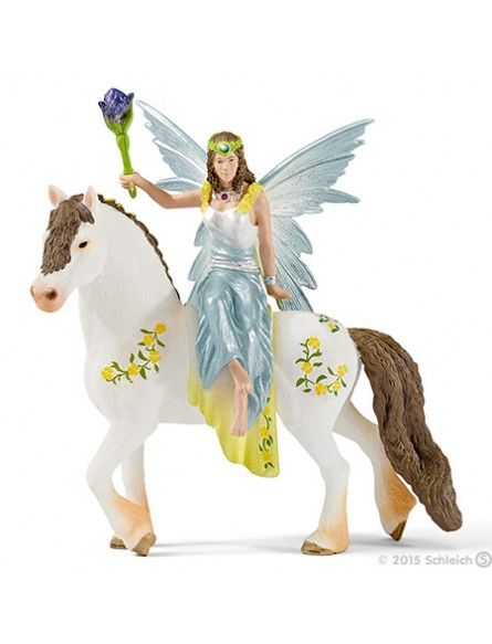 Schleich Schleich Eylea in Festive clothes, riding SC70516 Whoever sees Eyela riding past on her flower-bedecked horse recognises immediately that she is a real princess. It is neither the dress in her favourite colours, nor her beautiful jewellery, but rather the poise with which she sits on her beloved horse and spares a smile or friendly word for all her elves. Today she is bearing a mysterious blossom wand with whose help she wants to create a great surprise at the festival.