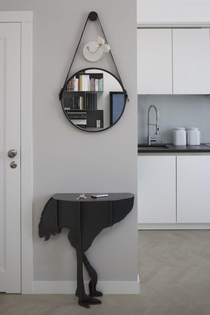 Apartment: Minimalist Krakow Apartment Designed by Morpho Studio, Krakow Apartment Hallway Mirror and Animal-shaped Table by Morpho Studio