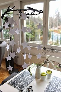 Hang a galaxy of white paper stars over the table.