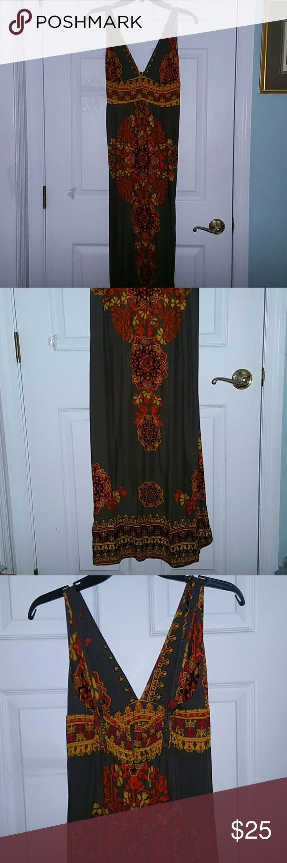 CUTE & COMFY FLORAL&PAISLEY MAXI DRESS FSU COLORS! ~ ANGIE ~ CUTE, COMFY, LIGHTWEIGHT, SEXY SPRING/SUMMER FESTIVAL MAXI DRESS. DEEP V NECK, ADJUSTABLE STRAPS WITH BUTTON & BUTTON HOLES,  SMOCKED (STRETCHY) BACK. DARK GREY, GOLD, RED, ORANGE, BLACK.  Size: MEDIUM  EEUC Excellent Preloved Condition. Worn Once to a FSU Seminoles Game! Gently Laundered, and Hung To Dry.  100% Rayon  No Smoking, Buy It Now, Bundle Discounts Available, Reasonable Offers Only, Sorry NO Trades!  HAPPY SHOPPING=)…