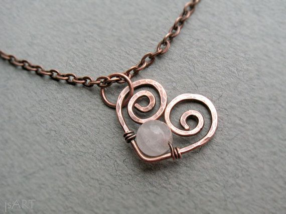 This beautiful, delicate copper necklace made with hand forged swirly heart. It is accented with a smooth rose quartz gemstone bead. Finished up with a fine solid copper chain and a lobser clasp. It was hammered, oxidized and hand polished for more style and depth.  ♥ Unconditional love ♥ Self-love ♥ Mother love ♥ Caring ♥ Kindness ♥ Friendship ♥ Romantic love ♥ Platonic love ♥  ROSE QUARTZ is a rose pink variety of Quartz and a 5th Anniversary gemstone.  Chakras - Heart Chakra Zodiac…
