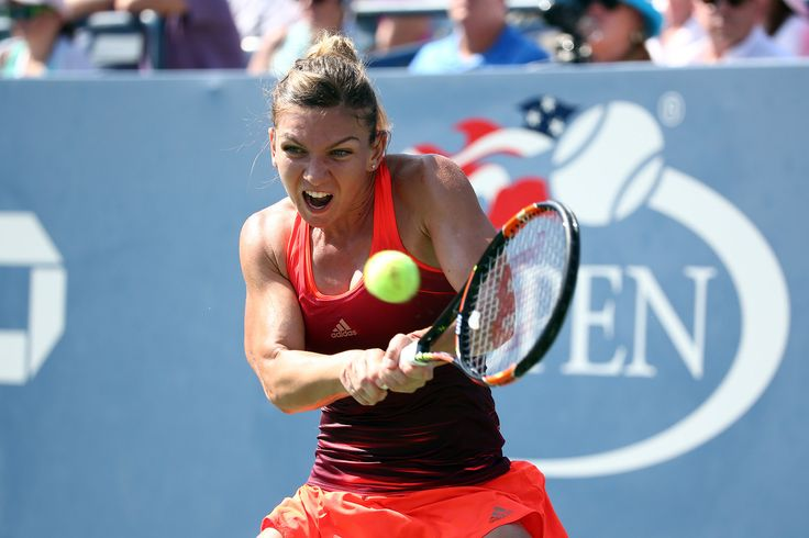 PHOTOS: Pennetta and Halep get to the semis