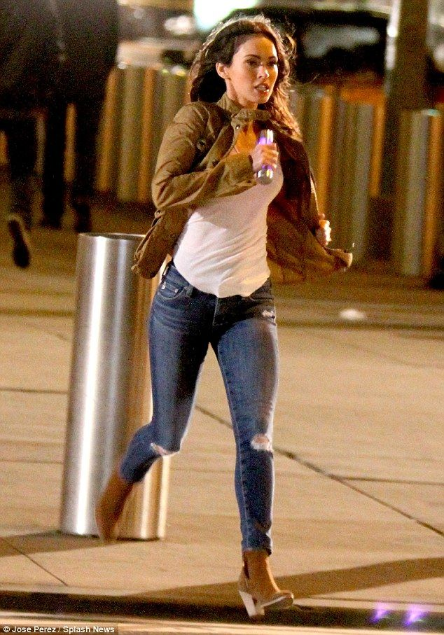 Injecting some glamour: Megan Foxstops traffic as she runs through the streets of New York while filming Teenage Mutant Ninja Turtles 2 on Monday evening