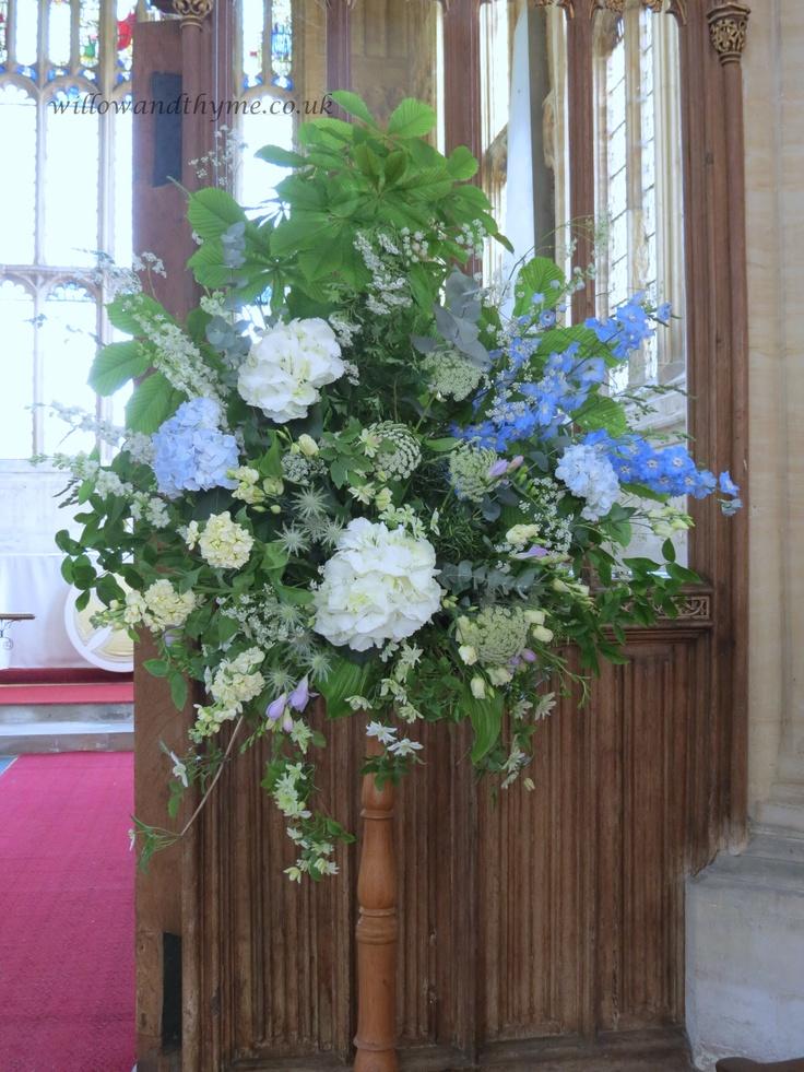 Pedestal with pale blue & white hydrangeas, larkspur, ammi and clematis