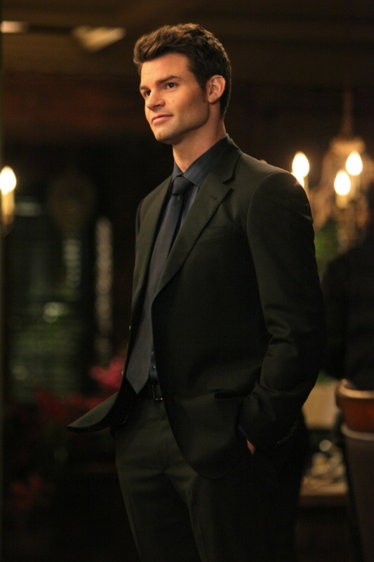 Elijah - Vampire Diaries.  His suit is practically a character.