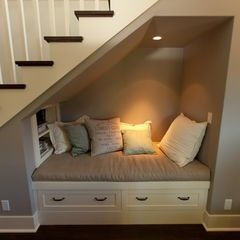 A small nook with a light, pillows, shelves, and drawer storage. Not only is it relaxing but it would make great use for the space under stairs, especially in a finished basement. It also looks comfy enough for children to use for sleep overs or severe weather.: