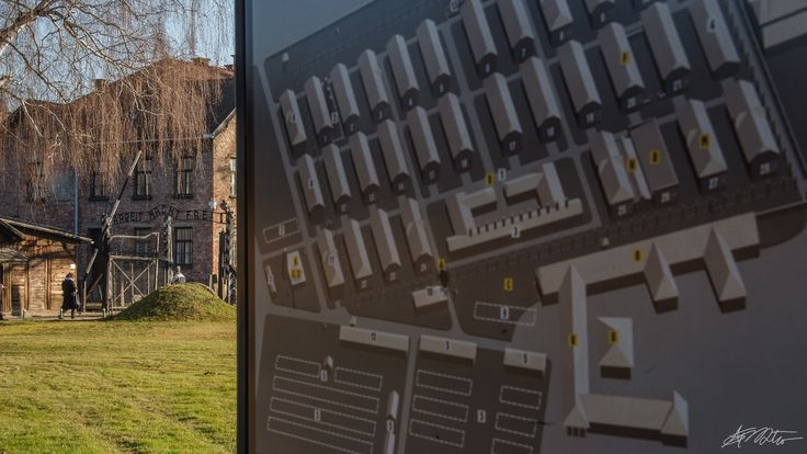 'Arbeit macht frei' gate in the background. In front - the map of the Auschwitz I camp.
