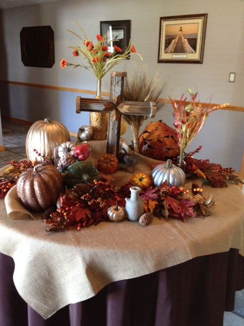 Foyer table i decorated with a fall display at church