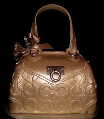 My 1st Coach purse cake... Not bad ;-)  Not Bad! It is Freaking Awesome! I love it! It looks so real