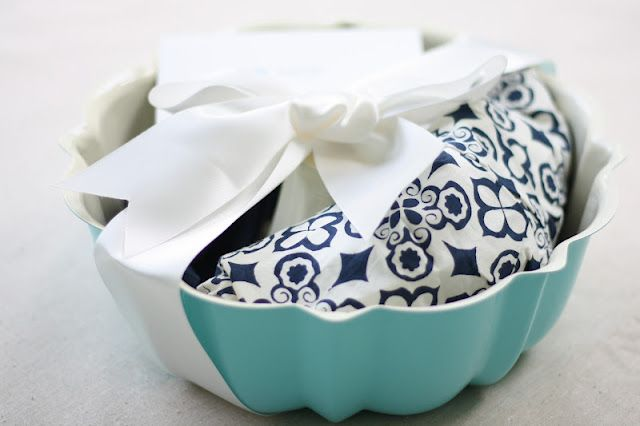 A bundt pan, an apron, and a recipe (such as Monkey Bread) to make in the bundt pan, wrapped with a ribbon. Cute for a wedding shower gift or hostess gift!
