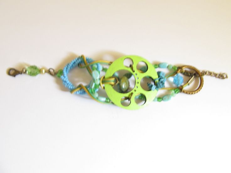 Handmade laser cut leather beaded bracelet (1 pc)  Made with light green leather filigree, turquoise stones, vintage brass metal, leather cords and glass beads.