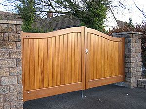 Best Wooden Gate Design | graceful swept top design with vertical boards ashleigh swept top