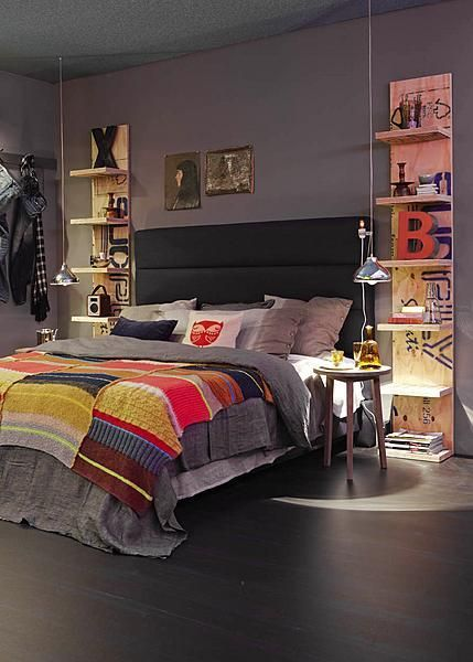 A tower of shelves to either side of the bed to draw the eye up and give more storage than nightstands.