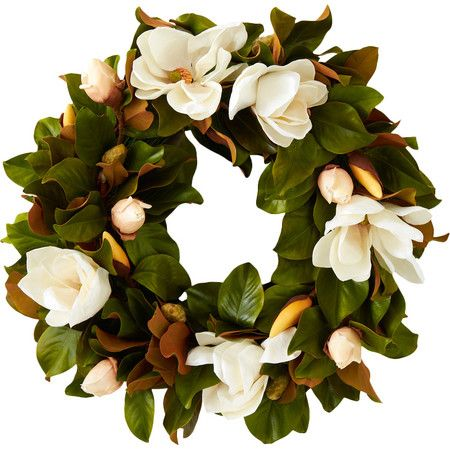 Evoke the summery South in your entryway or kitchen with this lush faux magnolia wreath, featuring crisp white blooms nestled among lovely leaves.